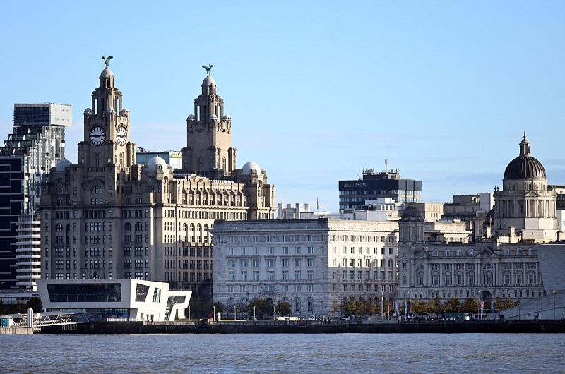 Buildings on Liverpool's waterfront, including the Liver Building, are pictured across the River Mersey, Liverpool, Britain, Oct. 12, 2020. (AFP Photo)