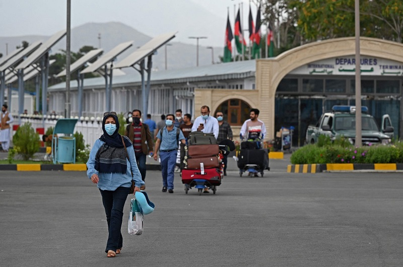Passengers walk out from the arrivals of the Hamid Karzai International Airport in Kabul on July 16, 2021. (AFP Photo)