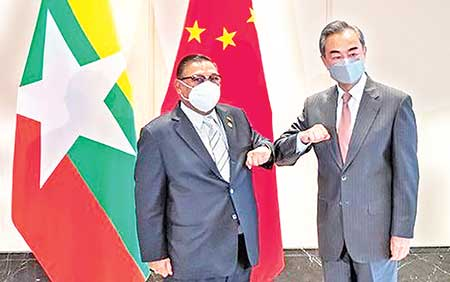 The Myanmar regime's Foreign Minister Wunna Maung Lwin and his Chinese counterpart Wang Yi in Chongqing on June 8./Chinese Foreign Ministry