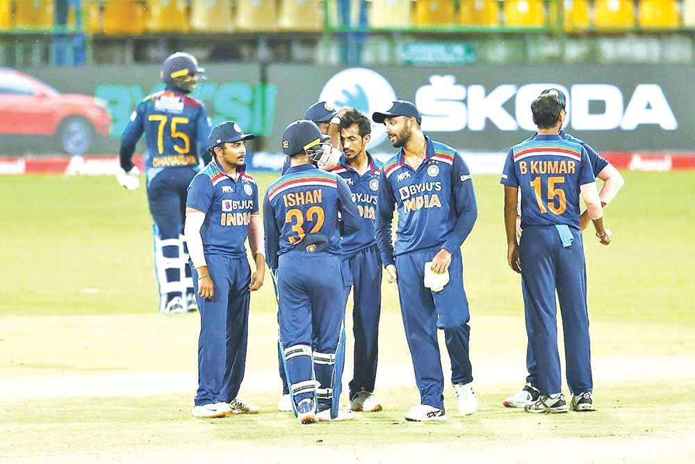 Yuzvendra Chahal of India celebrating with the teammates after dismissing Dhananjaya de Silva of Sri Lanka during the first T20i on Sunday. photo: SLC