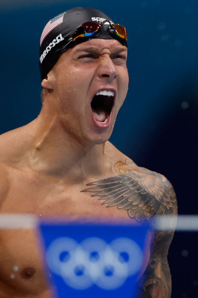 USA's Caeleb Dressel celebrates winning to take gold in the final of the men's 4x100m medley relay swimming event during the Tokyo 2020 Olympic Games at the Tokyo Aquatics Centre in Tokyo on August 1, 2021. photo: AFP