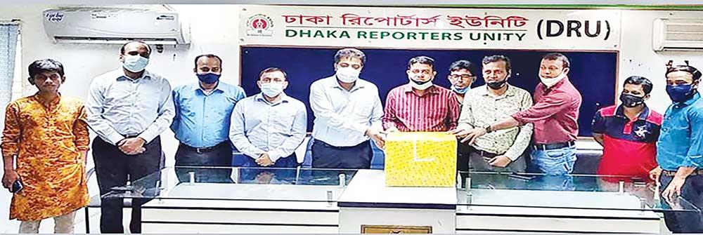 Kamruzzaman Kamal, Marketing Director at PRAN-RFL Group, handing a package of personal protective equipment to DRU President Morsalin Nomani and General Secretary Moshiur Rahman Khan at DRU office in the capital on Wednesday.