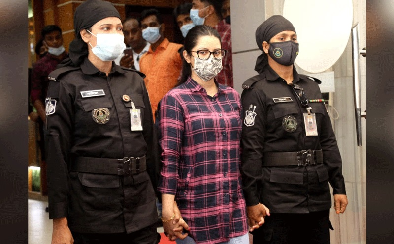 Actress Pori Moni was produced at a press conference held at the RAB Headquarters at Uttara in Dhaka on Thursday afternoon.