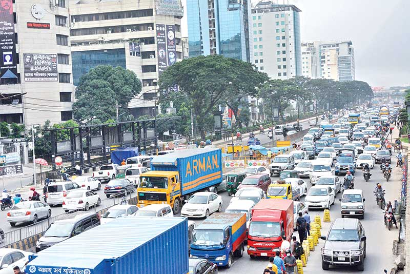 Kuril Bishwa Road in the capital sees huge traffic congestion on Thursday, although the ongoing countrywide 'strict lockdown' has been extended till August 10. Increasing number of vehicles and commuters now make the city streets hardly distinguishable from usual days.  photo : Observer