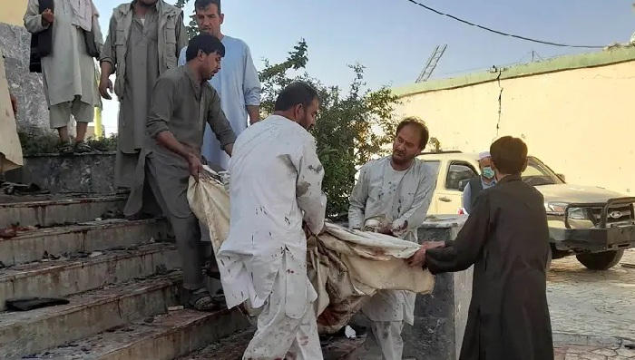 People carry the body of a victim from a mosque following a bombing in Kunduz province, northern Afghanistan, Friday. (AP)