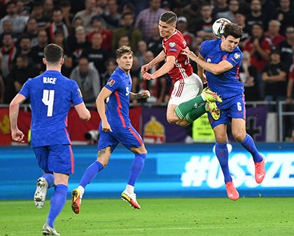 Hungary's forward Roland Sallai (2nd L) and England's defender Harry Maguire (R) vie for the ball during the FIFA World Cup Qatar 2022 qualification Group I football match between Hungary and England, at the Puskas Arena in Budapest on September 2, 2021.photo: AFP