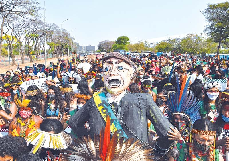 Indigenous female protesters burn an effigy of Brazilian President Jair Bolsonaro