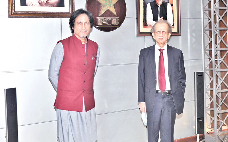 Newly elected PCB chief Ramiz Raja and PCB Election Commissioner, Justice (retd) Sheikh Azmat Saeed poses for photograph.photo: pCB