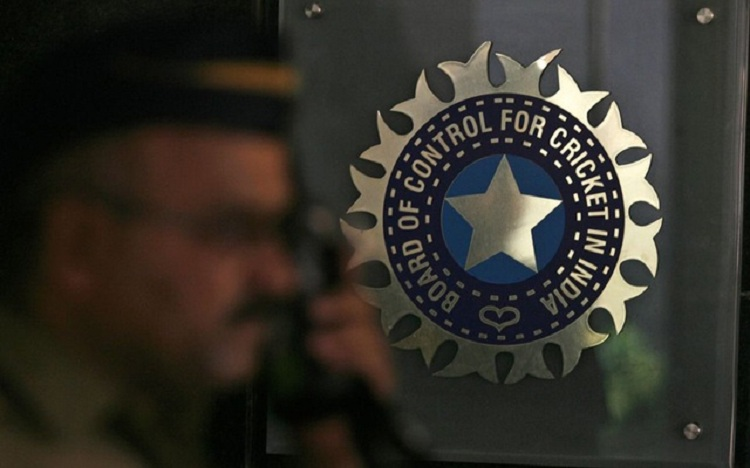 A policeman walks past a logo of the BCCI during a governing council meeting of the IPL at BCCI headquarters in Mumbai April 26, 2010. Photo: Reuters/Arko Datta