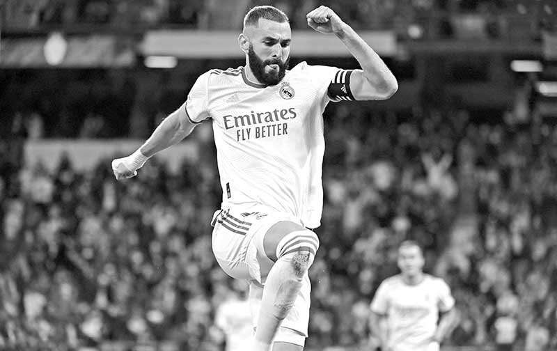 Real Madrid's French forward Karim Benzema celebrates scoring his team's fifth goal during the Spanish League footbal match between Real Madrid CF and Real Mallorca at the Santiago Bernabeu stadium in Madrid on September 22, 2021.photo: AFP