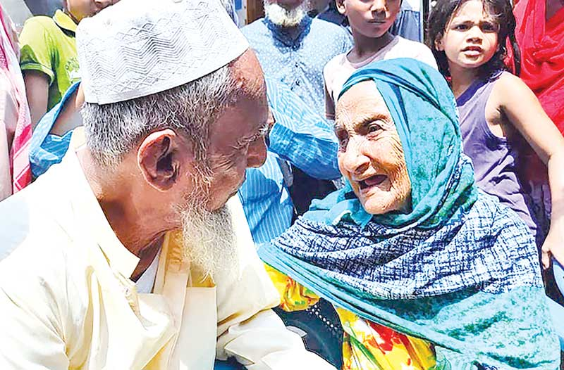 A REUNION EXTRAORDINARY: Eighty-year-old Abdul Kuddus Munshi meets his centenarian mother at Nabinagar in Brahmanbaria on Saturday, 70 years after he was lost, fleeing from home at the tender age of 10. PHOTO: OBSERVER