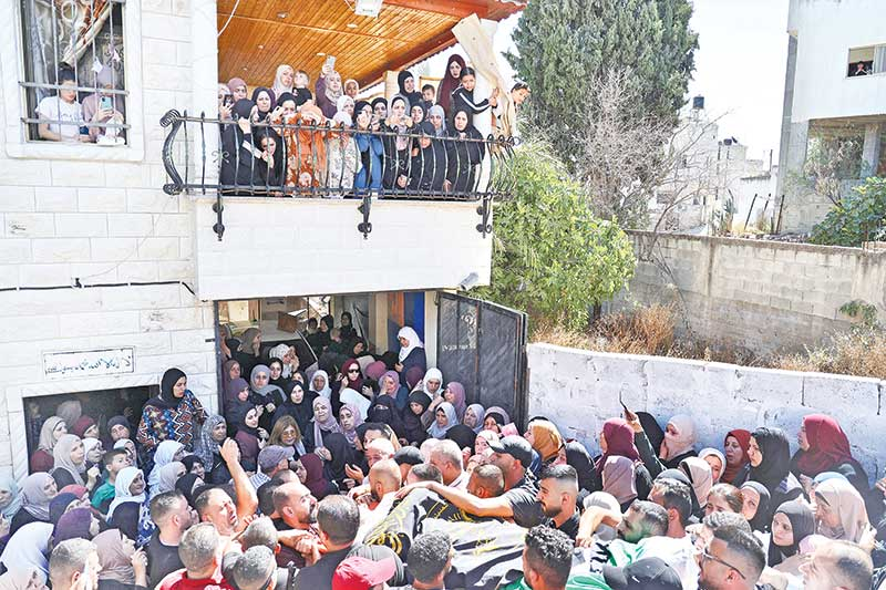 Mourners carry the body of Osama Sobh, a Palestinian killed by Israeli soldiers