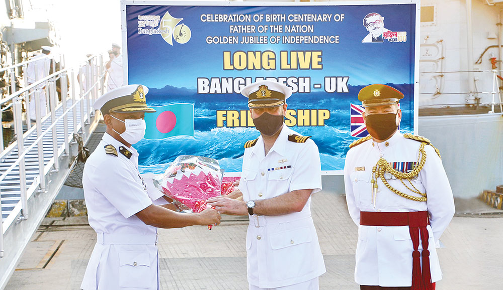 Chief Staff Officer of Commander Chattogram Naval Area Captain SM Moyeen Uddin welcomes UK Commander MJ (Matt) Sykes RN after the UK Royal Navy warship HMS Kent arrived at Chattogram Port Jetty on Thursday morning marking the birth centenary of Father of the Nation Bangabandhu Sheikh Mujibur Rahman and the golden jubilee of the country's independence.photo : ISPR